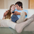 in love couple watching television in their living room stock photo © wavebreak_media