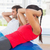 Fit young couple exercising on fitness balls in gym stock photo © wavebreak_media