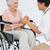 улыбаясь · старший · пациент · сидят · коляске · говорить - Сток-фото © wavebreak_media