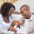 счастливым · молодые · родителей · время · ребенка · диване - Сток-фото © wavebreak_media