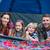 glückliche · Familie · zwei · Kinder · Sitzung · Gras · grünen · Gras - stock foto © wavebreak_media
