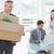 sad businessman carrying a box stock photo © wavebreak_media