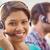 pretty smiling businesswoman working in a call centre stock photo © wavebreak_media