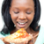 Jolly young woman eating a pizza  stock photo © wavebreak_media