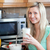 glimlachende · vrouw · gezonde · ontbijt · keuken · home · vrouw - stockfoto © wavebreak_media