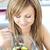 güzel · genç · kadın · yeme · meyve · salatası · mutfak · ev - stok fotoğraf © wavebreak_media