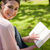 nő · néz · oldal · mosolyog · olvas · könyv - stock fotó © wavebreak_media