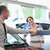 Car dealer shaking hand with a smiling man in a car shop stock photo © wavebreak_media