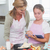 happy mother and daughter preparing cake together with tablet stock photo © wavebreak_media