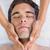 man receiving facial massage at spa center stock photo © wavebreak_media