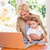 smiling pretty blonde woman using laptop with his son stock photo © wavebreak_media