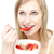 Charming woman eating cereals with strawberries  stock photo © wavebreak_media