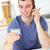 encantado · homem · falante · telefone · usando · laptop · cozinha - foto stock © wavebreak_media