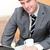 忙しい · ビジネスマン · ノートパソコン · 携帯電話 · マグ · 座って - ストックフォト © wavebreak_media