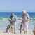 elderly couple with their bikes on the beach stock photo © wavebreak_media
