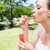 bride blowing bubbles in garden stock photo © wavebreak_media