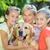 mãe · parque · cão · sorridente · flor · crianças - foto stock © wavebreak_media