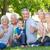 счастливая · семья · женщину · рук · дерево - Сток-фото © wavebreak_media