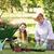 happy grandmother with her granddaughter gardening stock photo © wavebreak_media