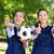 pretty football players smiling at camera stock photo © wavebreak_media