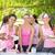 smiling women organising event for breast cancer awareness stock photo © wavebreak_media