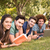 Happy friends in the park studying stock photo © wavebreak_media