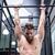férfi · húzás · fiatal · sportos · sportruha · felfelé - stock fotó © wavebreak_media