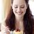 Smiling woman eating a sweet dessert stock photo © wavebreak_media