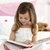 little girl sitting on bed reading a book stock photo © wavebreak_media