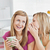 Close female friends talking together with a cup of coffee at home in the living-room stock photo © wavebreak_media