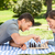couple playing chess in the park stock photo © wavebreak_media