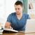 mannelijke · student · met · behulp · van · laptop · huiswerk · boeken · school - stockfoto © wavebreak_media