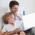 gülen · baba · çocuk · yatak · dizüstü · bilgisayar · birlikte - stok fotoğraf © wavebreak_media