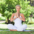 young woman on the grass doing yoga exercises stock photo © wavebreak_media