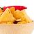 Pepper upon a bowl full of crisps against white background stock photo © wavebreak_media