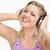 uśmiechnięty · słuchawki · dotknąć · biały - zdjęcia stock © wavebreak_media