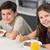 smiling young siblings enjoying breakfast in kitchen stock photo © wavebreak_media