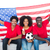 happy football fans in red sitting on couch with usa flag stock photo © wavebreak_media