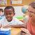pretty teacher helping pupil in classroom stock photo © wavebreak_media
