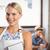 smiling blonde waitress posing in front of customer stock photo © wavebreak_media