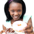 Pretty young woman holding a donut  stock photo © wavebreak_media