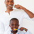 father and his son brushing their teeth stock photo © wavebreak_media