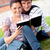 Smiling couple of students reading a book sitting on grass at their campus university stock photo © wavebreak_media