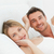 cute couple lying down together in their bed stock photo © wavebreak_media
