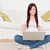 beautiful female relaxing with her laptop while siting on a carpet in the living room stock photo © wavebreak_media