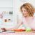 aantrekkelijk · blonde · vrouw · ontspannen · laptop · koken · groenten - stockfoto © wavebreak_media