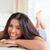 bonitinho · mulher · tapete · sorridente · câmera - foto stock © wavebreak_media