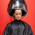 Portrait of a woman under a hairdressing machine against a red background stock photo © wavebreak_media