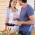 portrait of a beautiful couple cooking with a pan in their kitchen stock photo © wavebreak_media
