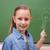 mosolyog · iskolás · lány · mutat · villanykörte · iskolatábla · iskola - stock fotó © wavebreak_media